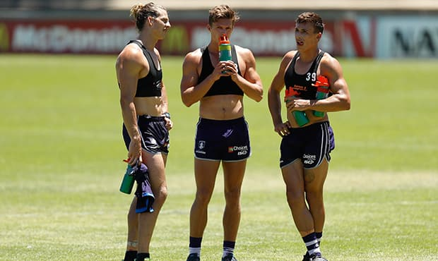 PERTH, AUSTRALIA - JANUARY 16: (L-R) Nat Fyfe, Darcy Tucker and Josh Deluca of the Dockers chat during the Fremantle Dockers training session at Fremantle Oval on January 16, 2017 in Perth, Australia. (Photo by Michael Willson/AFL Media)