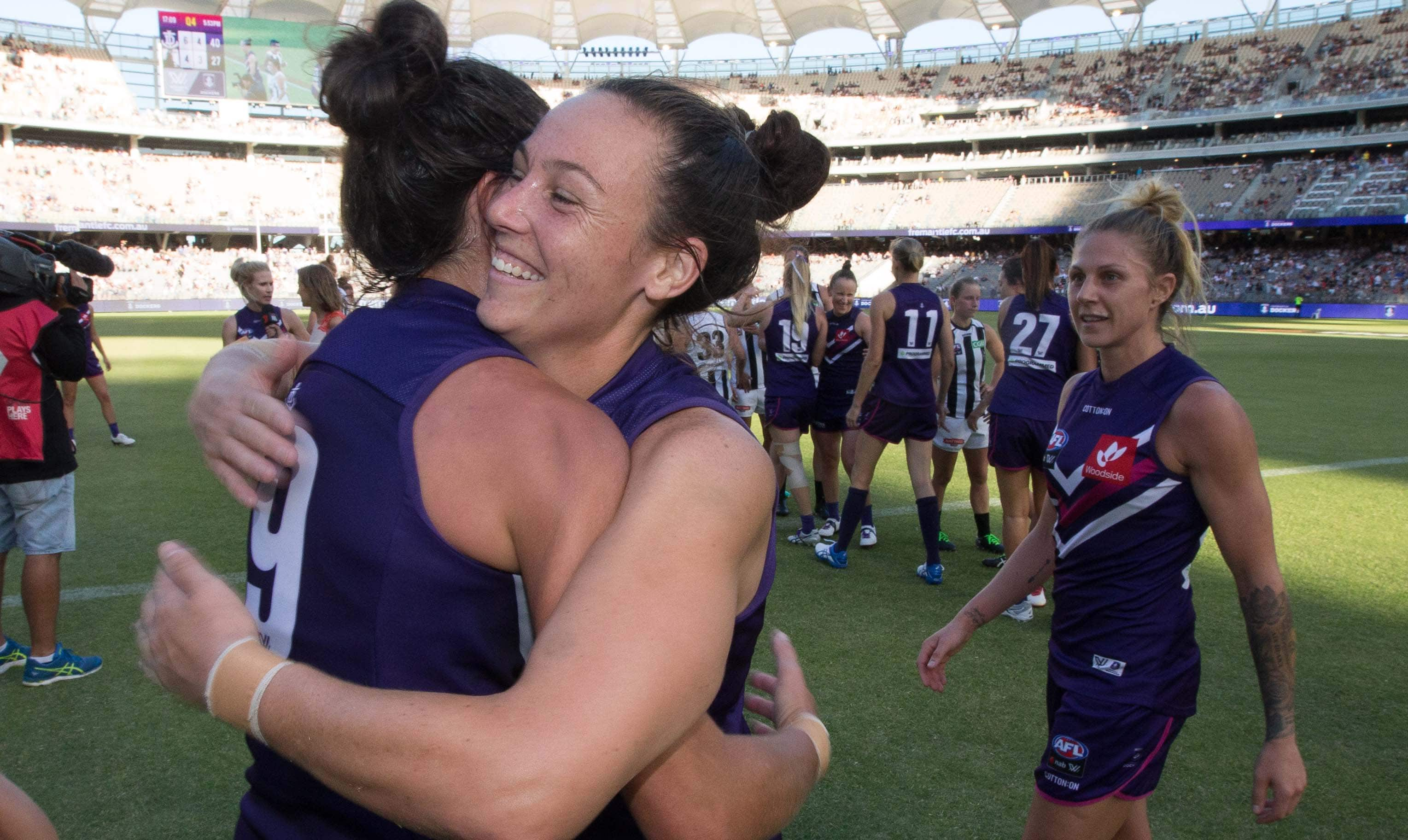 Ashlee Atkins embraces Alex Williams after Freo's round two AFLW win at Optus Stadium.