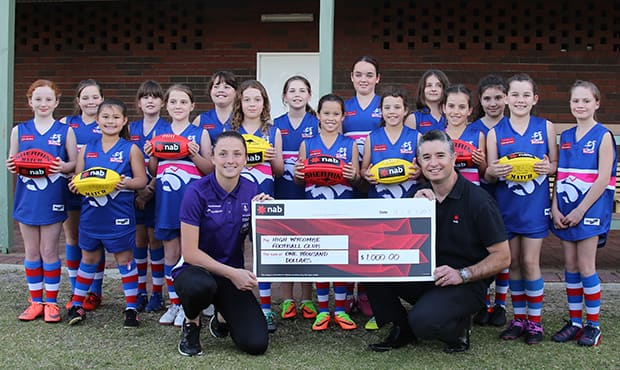 Ashley Sharp with her local junior football club, the High Wycombe Bulldogs.