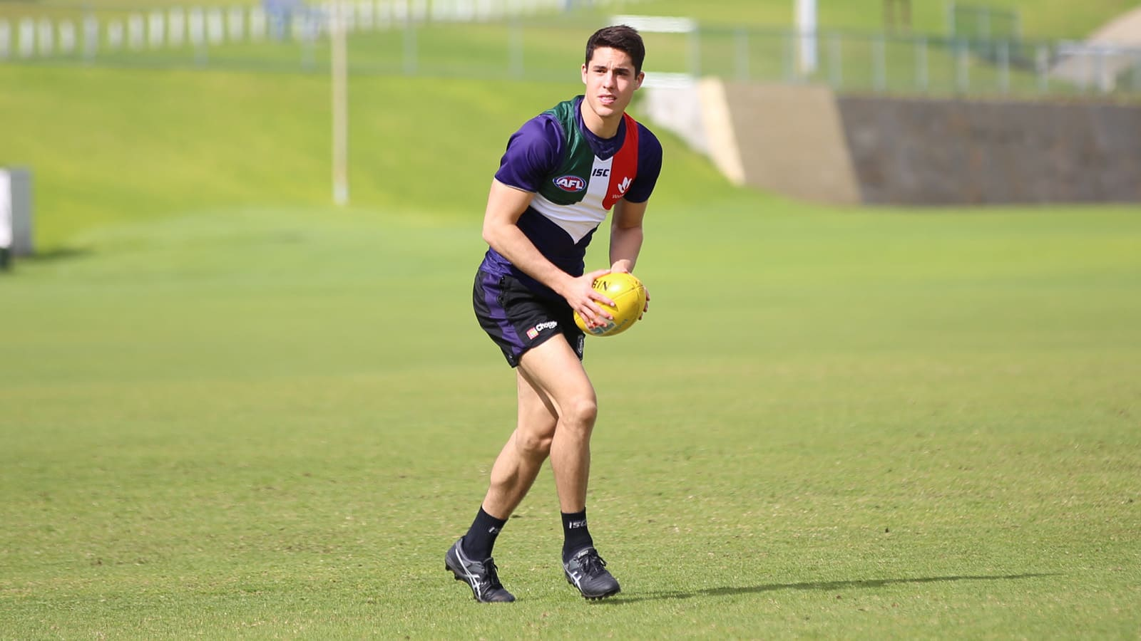 Adam Cerra training in Freo's 'anchor' jumper in Cottesloe on Wednesday. - Fremantle,Fremantle Dockers,Essendon Bombers,Essendon