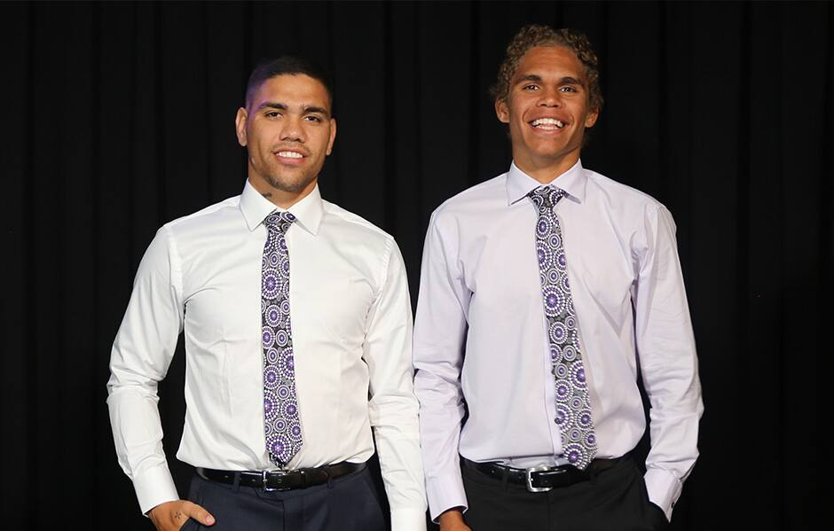 Michael Walters and Liam Henry model the 'Tied to Culture' ties. - Fremantle,Fremantle Dockers