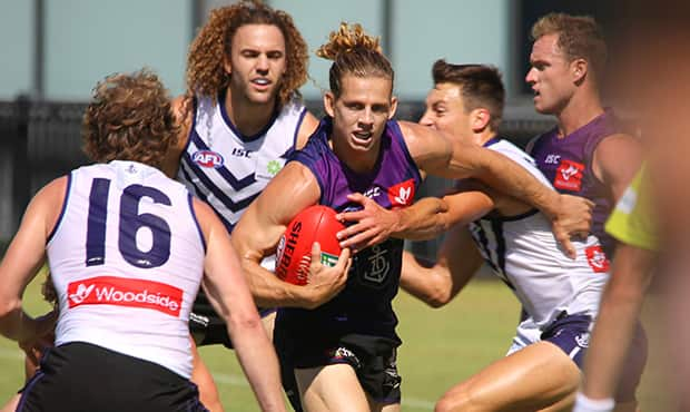Nat Fyfe bursting through the pack during Friday's intra-club match. - Fremantle,Fremantle Dockers