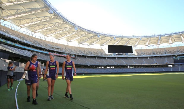 Gabby O'Sullivan, Amy Lavell and Ebony Antonio tour Optus Stadium on Monday.