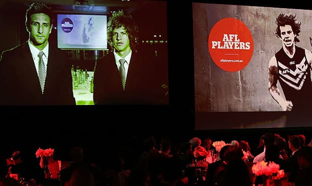 Nat Fyfe with skipper Matthew Pavlich on screen from Perth during the AFLPA awards in Melbourne. Picture: Getty Images