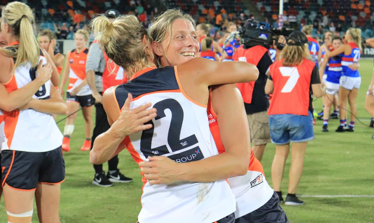 Cora Staunton embraces Elle Bennetts after the GIANTS' round six win over the Western Bulldogs. - GWS Giants,AFLW,Cora Staunton