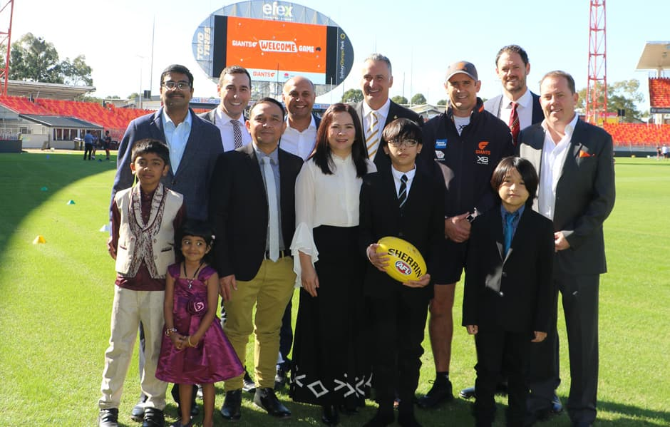 Hon. Minister John Sidoti, NSW Minister for Multiculturalism and Sport, GIANTS CEO David Matthews, GIANTS coach Leon Cameron, GIANTS Board Member Adrian Fonseca, AFL NSW/ACT CEO Sam Graham and Multicultural NSW CEO Joseph La Posta meet with two of the families who will be part of the GIANT Citizenship Ceremony on Sunday. - AFL,GWS Giants,GIANTS Stadium,Carlton