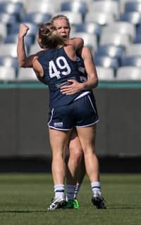 Kate Darby celebrates a goal on Saturday - Geelong Cats
