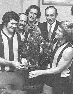 Leigh Matthews, Peter Crimmins and fellow teammates with the Club Mascot.