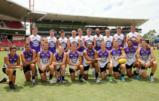 Josh Gibson and Sam Mitchell join fellow AFL players for a photo before the exhibition match in Western Sydney.