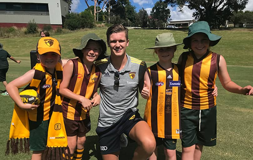 Mitchell Lewis stops for a photo with some excited young Hawthorn fans.