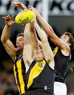 Richmond's Graham Polak jumps high in a marking contest