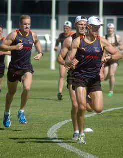 Nathan van Berlo checks his time during the five-minute run