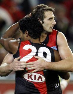 Jobe Watson embraces Alwyn Davey during the Bombers' tense final term at the MCG
