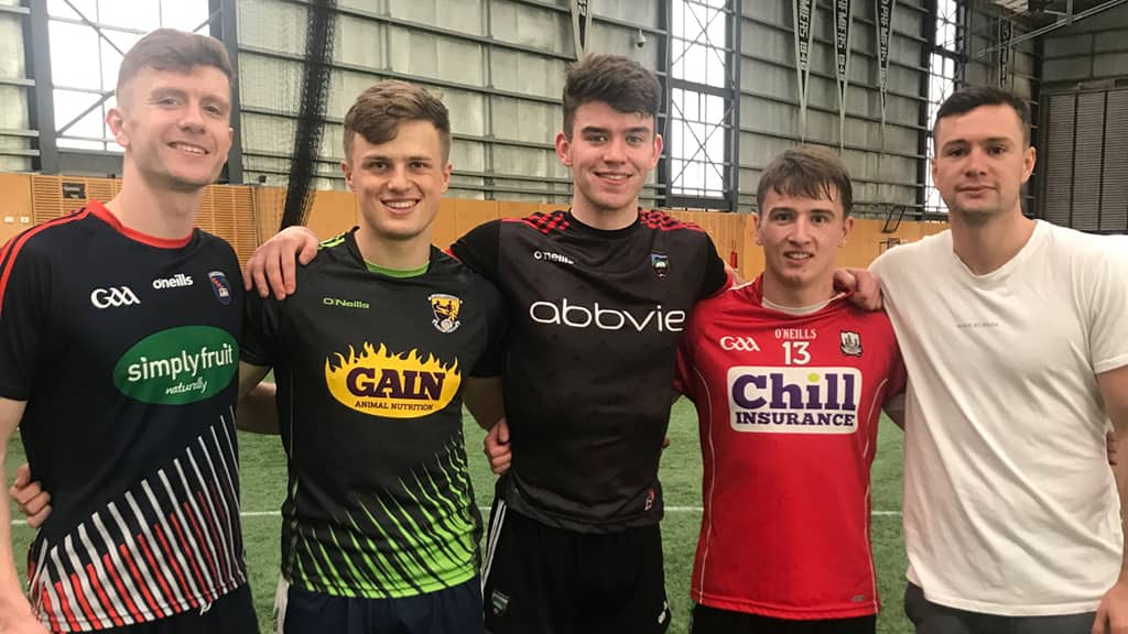 Luke Towey (middle) with other Irish prospects and Bomber Conor McKenna - AFL,Gold Coast Suns