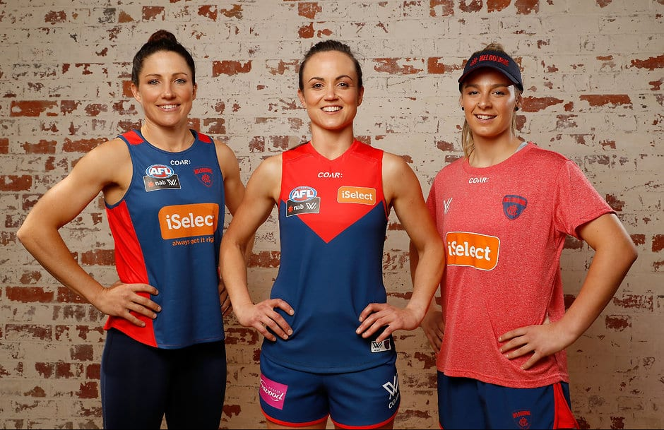 MELBOURNE, AUSTRALIA - NOVEMBER 10: (L-R) Melbourne Demon players Melissa Hickey, Daisy Pearce and Deanna Berry pose with their new onfield and training apparel during the AFL Womens Apparel Launch at Kensington Collective in Melbourne, Australia on November 10, 2016. (Photo by Adam Trafford/AFL Media)