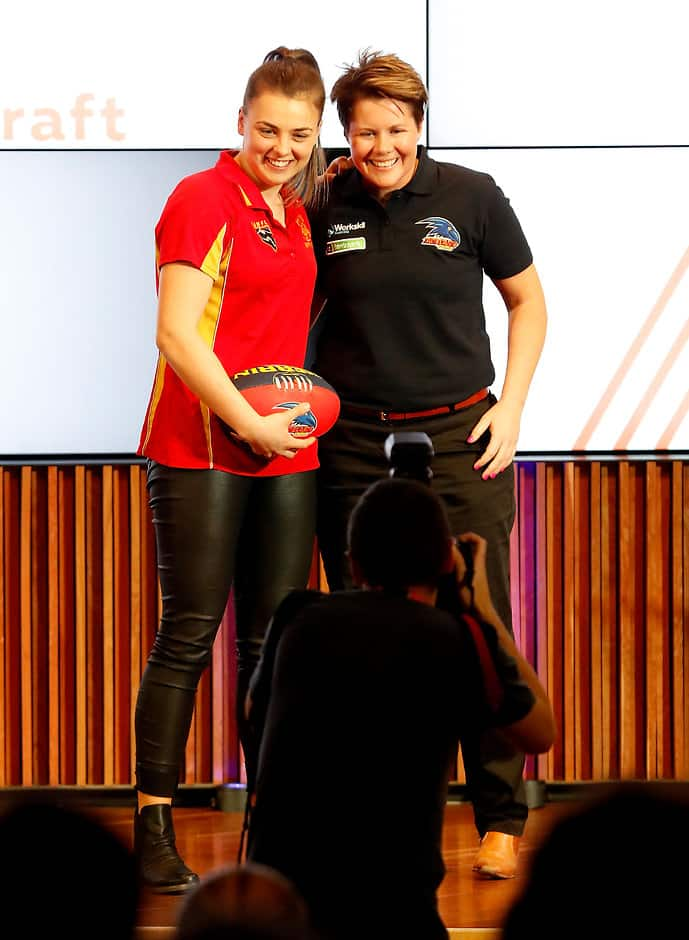 MELBOURNE, AUSTRALIA - OCTOBER 12: The number seven draft pick for the Adelaide Crows Ebony Marinoff is announced and poses with coach Bec Goddard on stage during the 2016 NAB AFLW Draft at NAB Building on October 12, 2016 in Melbourne, Australia. (Photo by Justine Walker/AFL Media)