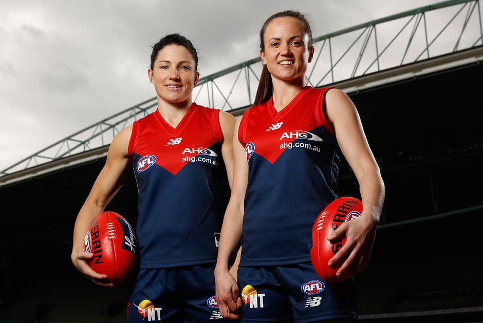 MELBOURNE, AUSTRALIA - JULY 27: Melissa Hickey (left) and Daisy Pearce of the Demons pose for a photograph  during the national women's league marquee players announcement at Etihad Stadium in Melbourne, Australia on July 27, 2016. (Photo by Michael Willson/AFL Media)