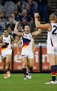 Scott Thompson of the Crows (centre) celebrates a goal during the 2014 AFL Round 10 match between Carlton Blues and the Adelaide Crows at Etihad Stadium, Melbourne on May 25, 2014. (Photo: Michael Willson/AFL Media)