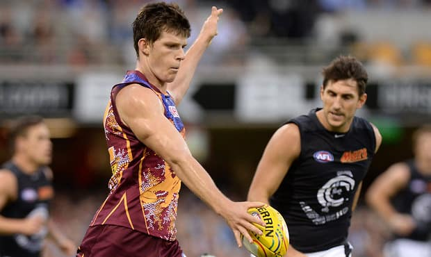 Justin Clarke of the Lions kicks the ball during the 2014 AFL Round 11 match between the Brisbane Lions and the Carlton Blues at the Gabba, Brisbane on May 31, 2014. (Photo: Bradley Kanaris/AFL Media)