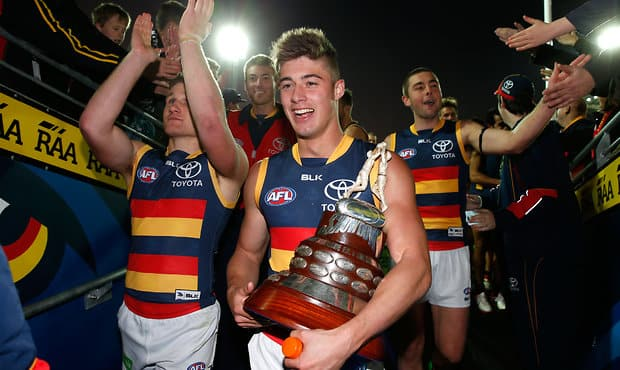 ADELAIDE, AUSTRALIA - JULY 19: Riley Knight of the Crows leads the team from the field after the 2015 AFL round 16 match between Port Adelaide Power and the Adelaide Crows at the Adelaide Oval, Adelaide, Australia on July 19, 2015. (Photo by Michael Willson/AFL Media)