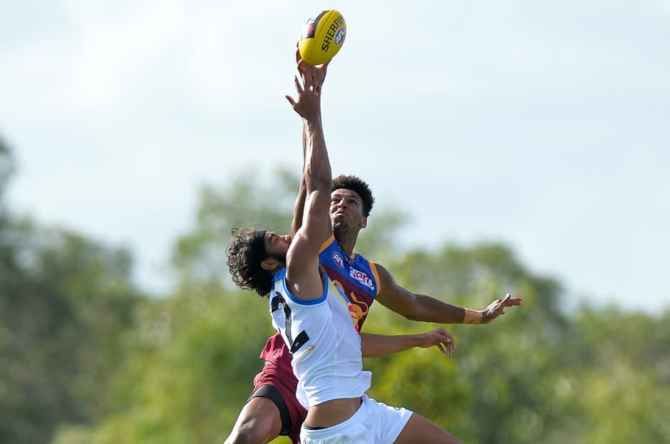 BURPENGARY, AUSTRALIA - FEBRUARY 21: Archie Smith of the Lions and Tom Nicholls of the Suns compete for the ball during the 2016 NAB Challenge match between the Brisbane Lions and the Gold Coast Suns at Moreton Bay Central Sports Complex, Burpengary on February 21, 2016. (Photo by Bradley Kanaris/AFL Media)