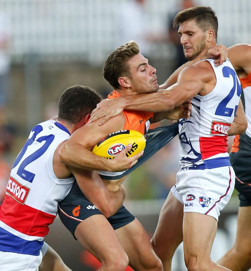 Giants stand-in skipper Stephen Coniglio feels the heat from the Dogs in Canberra - ${keywords}
