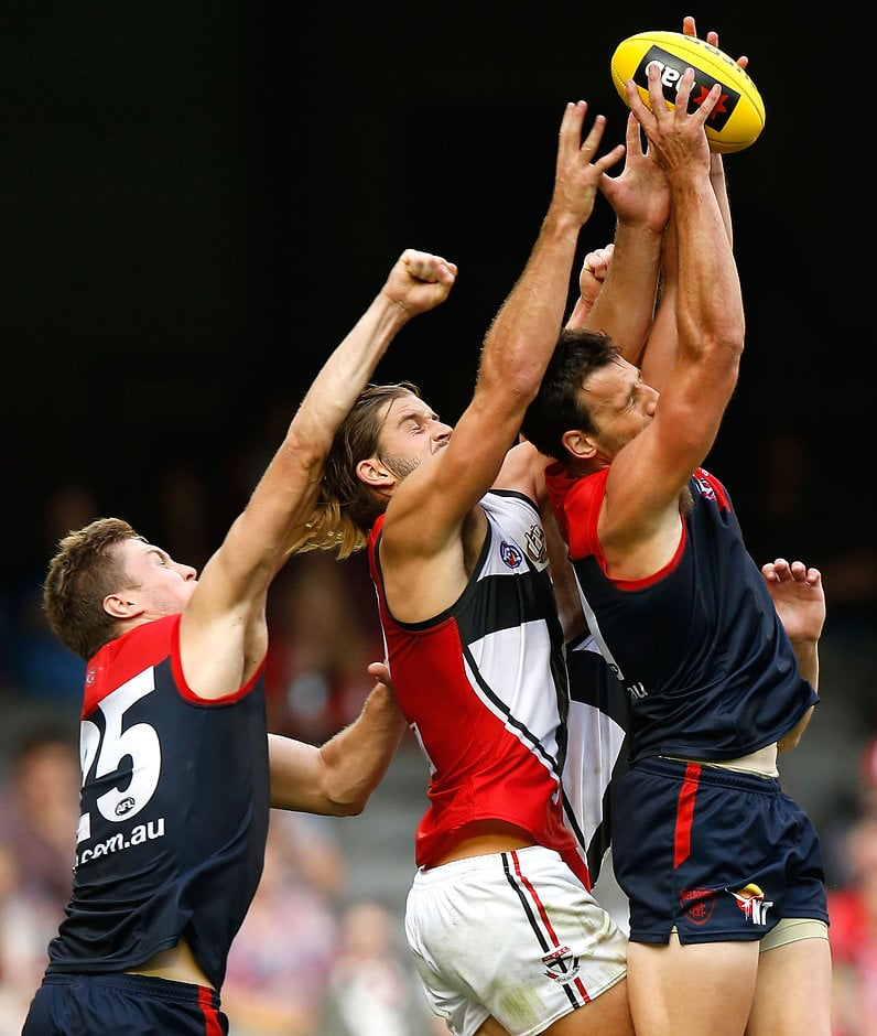 MELBOURNE, AUSTRALIA - MARCH 13: (L-R) Tom McDonald of the Demons, Josh Bruce of the Saints and Cameron Pedersen of the Demons compete for the ball during the 2016 NAB Challenge match between the Melbourne Demons and the St Kilda Saints at Etihad Stadium, Melbourne on March 13, 2016. (Photo by Michael Willson/AFL Media)