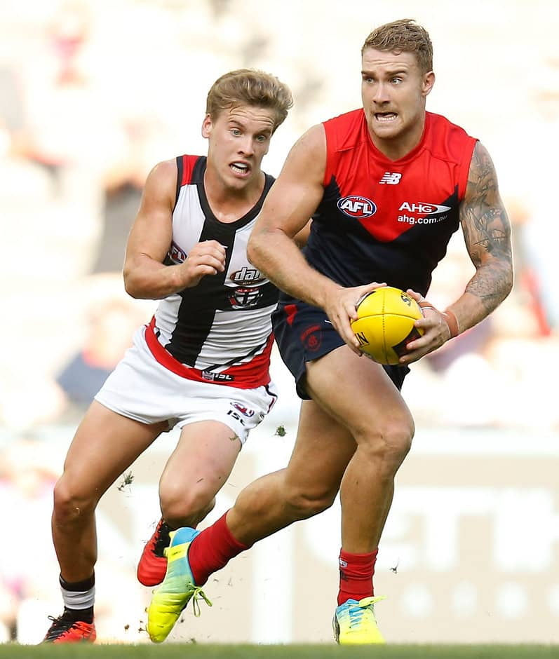 MELBOURNE, AUSTRALIA - MARCH 13: Dean Kent of the Demons is chased by Jack Lonie of the Saints during the 2016 NAB Challenge match between the Melbourne Demons and the St Kilda Saints at Etihad Stadium, Melbourne on March 13, 2016. (Photo by Michael Willson/AFL Media)