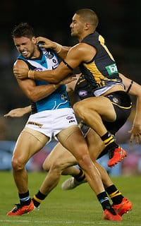 Travis Boak and Shaun Grigg collide on Thursday night at Etihad Stadium