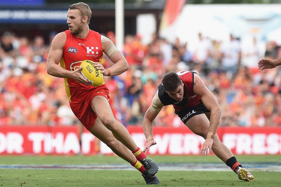 GOLD COAST, AUSTRALIA - MARCH 26: Trent McKenzie of the Suns runs with the ball during the 2016 AFL Round 01 match between the Gold Coast Suns and the Essendon Bombers at Metricon Stadium, Gold Coast on March 26, 2016. (Photo by Matt Roberts/AFL Media)
