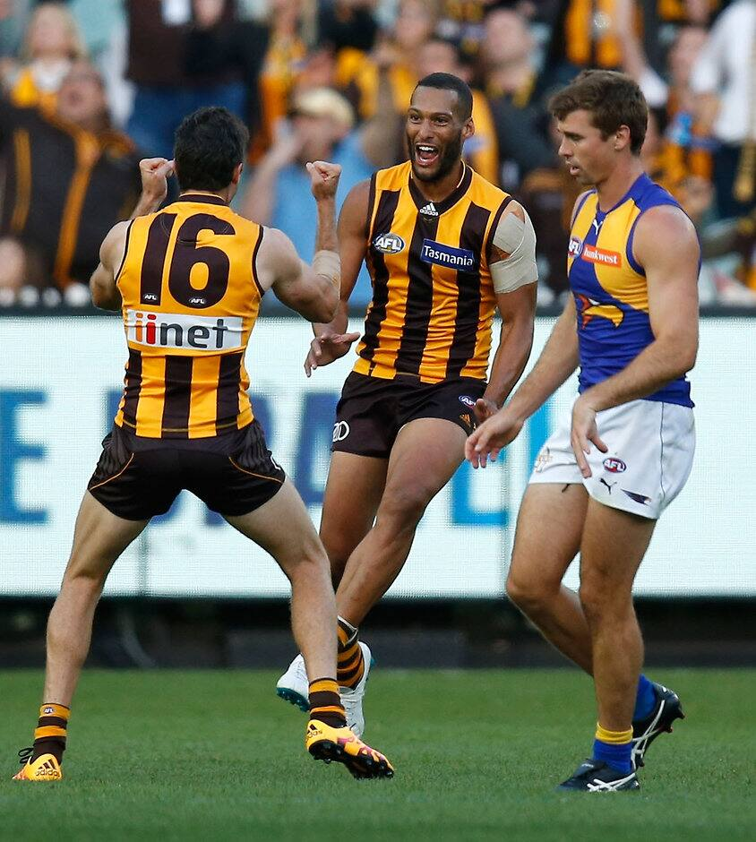 MELBOURNE, AUSTRALIA - APRIL 3: Josh Gibson of the Hawks celebrates his first goal for the Hawks with Isaac Smith (left) during the 2016 AFL Round 02 match between the Hawthorn Hawks and the West Coast Eagles at the Melbourne Cricket Ground, Melbourne on April 3, 2016. (Photo by Michael Willson/AFL Media)