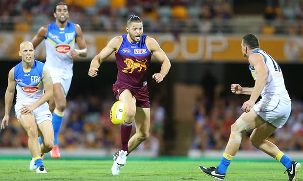 BRISBANE, AUSTRALIA - APRIL 16:  Stefan Martin of the Lions kicks during the round four AFL match between the Brisbane Lions and the Gold Coast Suns at The Gabba on April 16, 2016 in Brisbane, Australia.  (Photo by Chris Hyde/AFL Media/Getty Images)