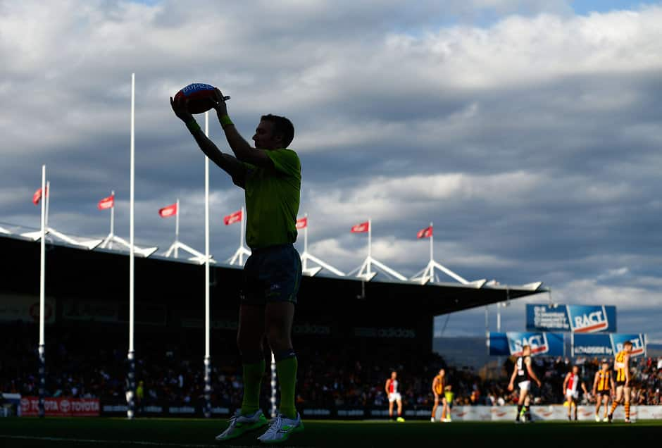 LAUNCESTON, AUSTRALIA - APRIL 16: The boundary umpire throws the ball in during the 2016 AFL Round 04 match between the Hawthorn Hawks and the St Kilda Saints at Aurora Stadium, Launceston on April 16, 2016. (Photo by Michael Willson/AFL Media)