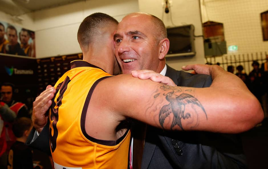 MELBOURNE, AUSTRALIA - APRIL 22: Shaun Burgoyne of the Hawks is hugged by CEO Stuart Fox after his 300th match during the 2016 AFL Round 05 match between the Hawthorn Hawks and the Adelaide Crows at the Melbourne Cricket Ground, Melbourne on April 22, 2016. (Photo by Michael Willson/AFL Media)