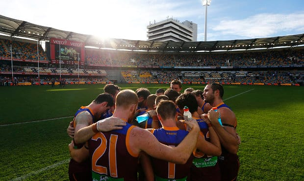 The boys in a huddle after Sunday's game against the Sydney Swans.