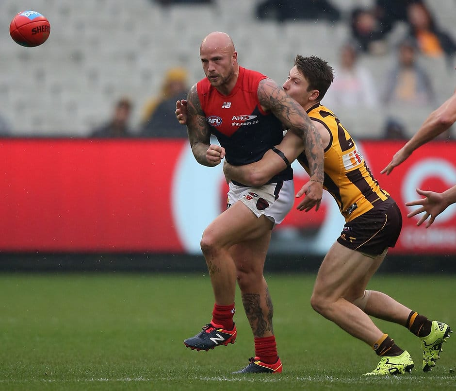 MELBOURNE, AUSTRALIA - JUNE 04: Nathan Jones of the Demons is tackled by Luke Breust of the Hawks during the 2016 AFL Round 11 match between the Hawthorn Hawks and the Melbourne Demons at the Melbourne Cricket Ground on June 4, 2016 in Melbourne, Australia. (Photo by Sean Garnsworthy/AFL Media)