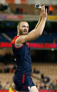 MELBOURNE, AUSTRALIA - JUNE 13: Neale Daniher Trophy winner Max Gawn of the Demons thanks fans during the 2016 AFL Round 12 match between the Melbourne Demons and the Collingwood Magpies at the Melbourne Cricket Ground on June 13, 2016 in Melbourne, Australia. (Photo by Adam Trafford/AFL Media)