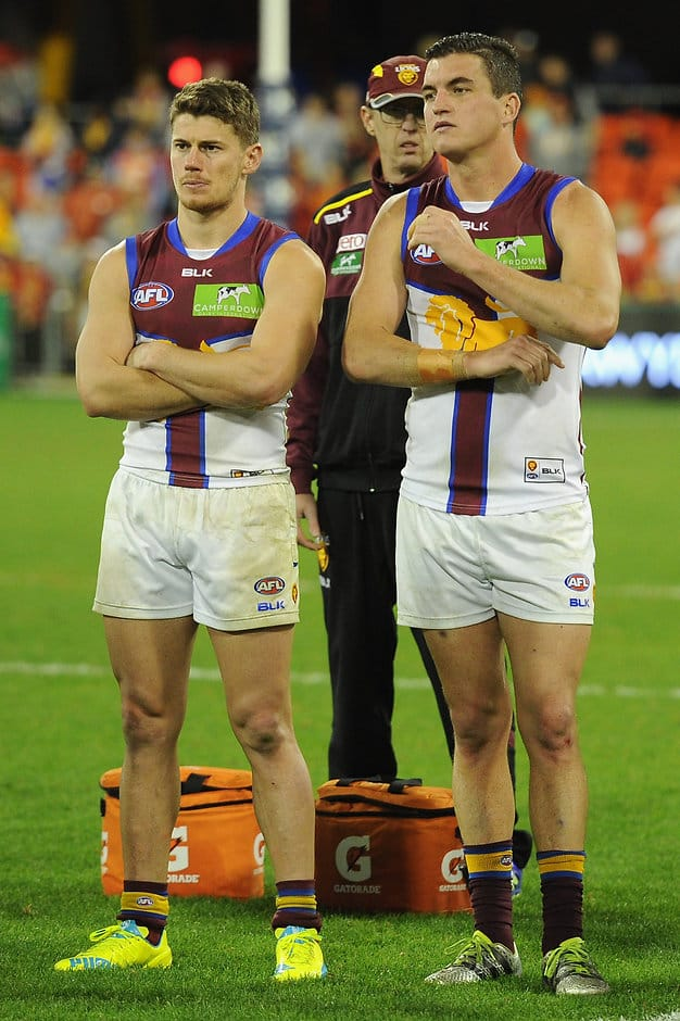GOLD COAST, AUSTRALIA - JULY 09: Dayne Zorko and Tom Rockliff of the Lions looks dejected during the 2016 AFL Round 16 match between the Gold Coast Suns and the Brisbane Lions at Metricon Stadium on July 9, 2016 in Gold Coast, Australia. (Photo by Matt Roberts/AFL Media)