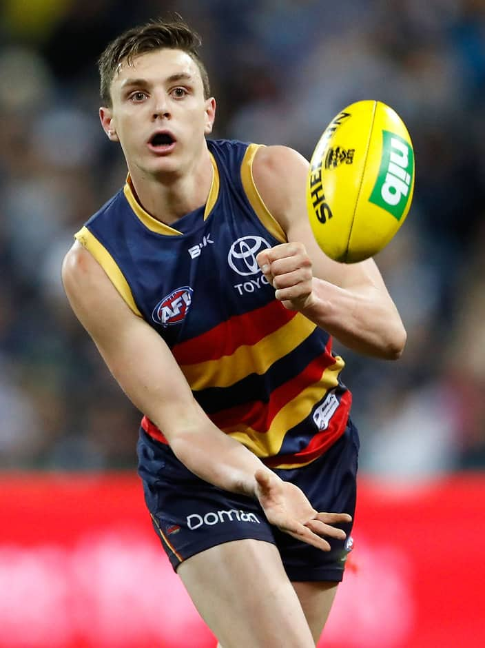 GEELONG, AUSTRALIA - JULY 23: Jake Lever of the Crows handpasses the ball during the 2016 AFL Round 18 match between the Geelong Cats and the Adelaide Crows at Simonds Stadium on July 23, 2016 in Geelong, Australia. (Photo by Adam Trafford/AFL Media)
