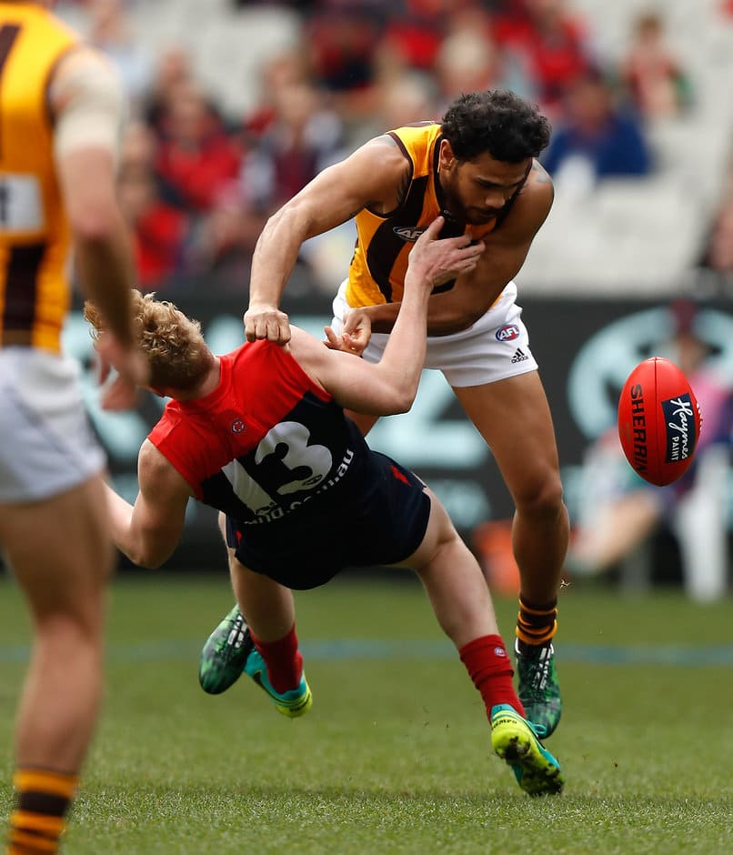 MELBOURNE, AUSTRALIA - AUGUST 06: Cyril Rioli of the Hawks and Clayton Oliver of the Demons collide during the 2016 AFL Round 20 match between the Melbourne Demons and the Hawthorn Hawks at the Melbourne Cricket Ground on August 06, 2016 in Melbourne, Australia. (Photo by Michael Willson/AFL Media)