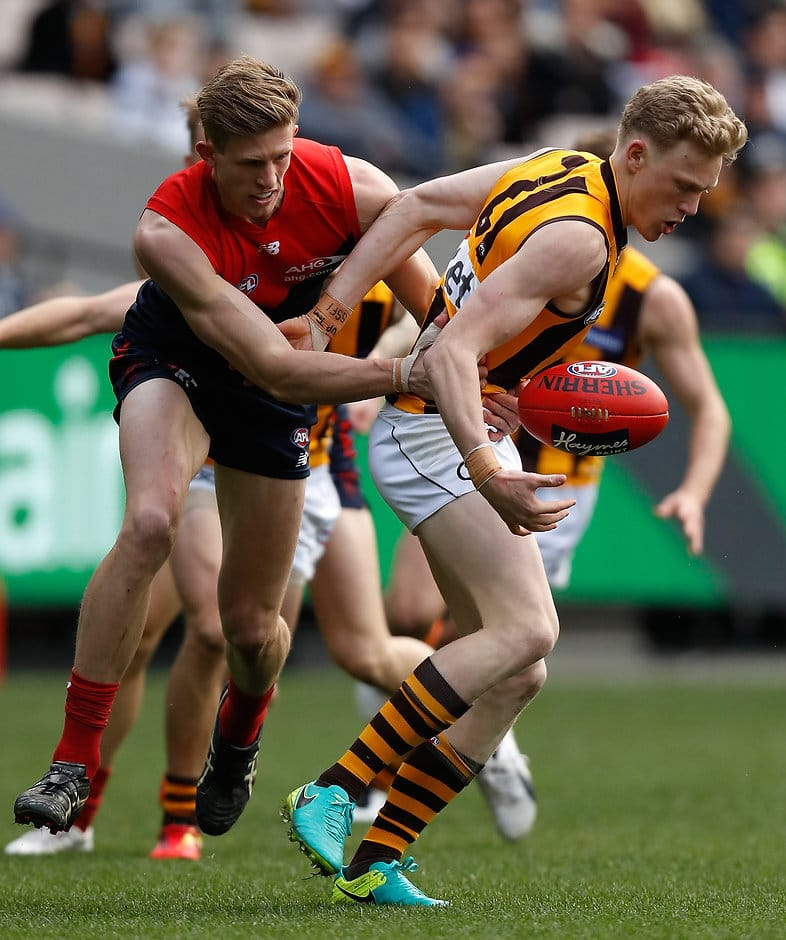 MELBOURNE, AUSTRALIA - AUGUST 06: James Sicily of the Hawks and Sam Frost of the Demons compete for the ball during the 2016 AFL Round 20 match between the Melbourne Demons and the Hawthorn Hawks at the Melbourne Cricket Ground on August 06, 2016 in Melbourne, Australia. (Photo by Michael Willson/AFL Media)