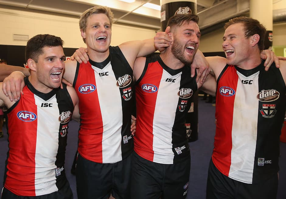 MELBOURNE, AUSTRALIA - AUGUST 28: St Kilda players celebrate winning the 2016 AFL Round 23 match between the St Kilda Saints and the Brisbane Lions at Etihad Stadium on August 28, 2016 in Melbourne, Australia. (Photo by Sean Garnsworthy/AFL Media)