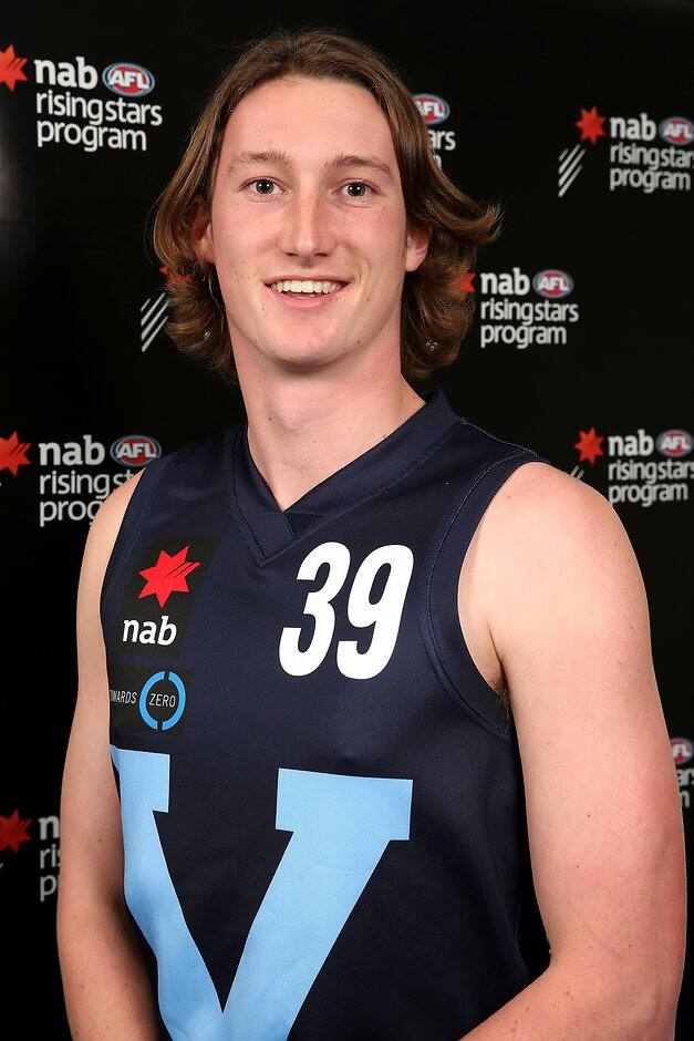 MELBOURNE, AUSTRALIA - JUNE 24: Lachlan Filipovic of Vic Metro poses during the Under 18 Championships headshot session at Etihad Stadium on June 24, 2016 in Melbourne, Australia. (Photo by Sean Garnsworthy/AFL Media)