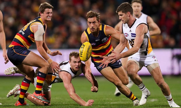 ADELAIDE, AUSTRALIA - JUNE 22: Matt Crouch and Richard Douglas of the Crows clash with Tom Mitchell and Luke Breust of the Hawks during the 2017 AFL round 14 match between the Adelaide Crows and the Hawthorn Hawks at the Adelaide Oval on June 22, 2017 in Adelaide, Australia. (Photo by AFL Media)