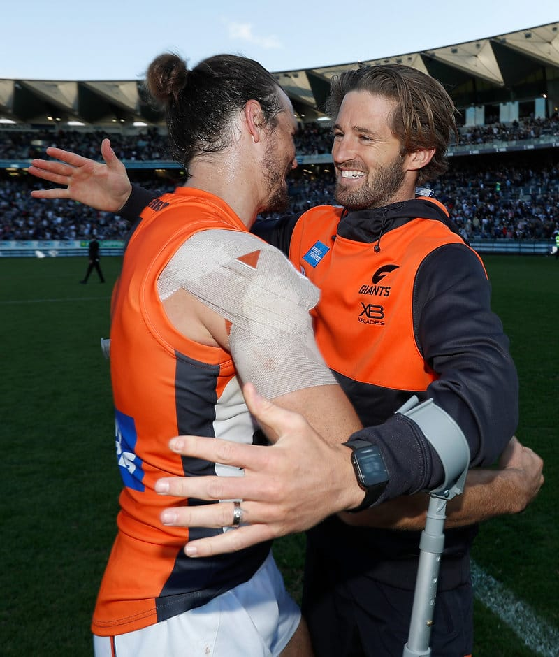 GEELONG, AUSTRALIA - APRIL 13: Phil Davis of the Giants and Callan Ward of the Giants celebrate during the 2019 AFL round 04 match between the Geelong Cats and the GWS Giants at GMHBA Stadium on April 13, 2019 in Geelong, Australia. (Photo by Michael Willson/AFL Photos)