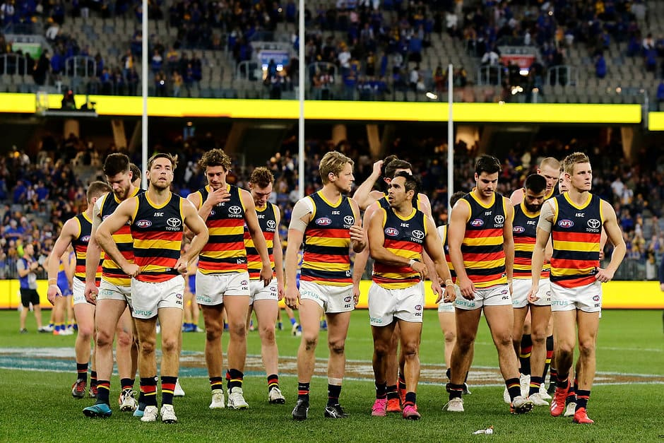 PERTH, AUSTRALIA - AUGUST 11: The Crows leave the field after the teams defeat during the 2019 AFL round 21 match between the West Coast Eagles and the Adelaide Crows at Optus Stadium on August 11, 2019 in Perth, Australia. (Photo by Will Russell/AFL Photos)