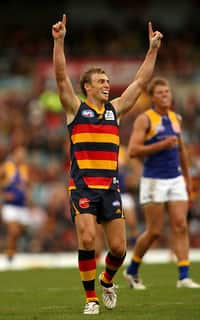 Simon Goodwin of the Crows celebrates a goal during the AFL Round 02 match between the Adelaide Crows and the West Coast Eagles at AAMI Stadium.