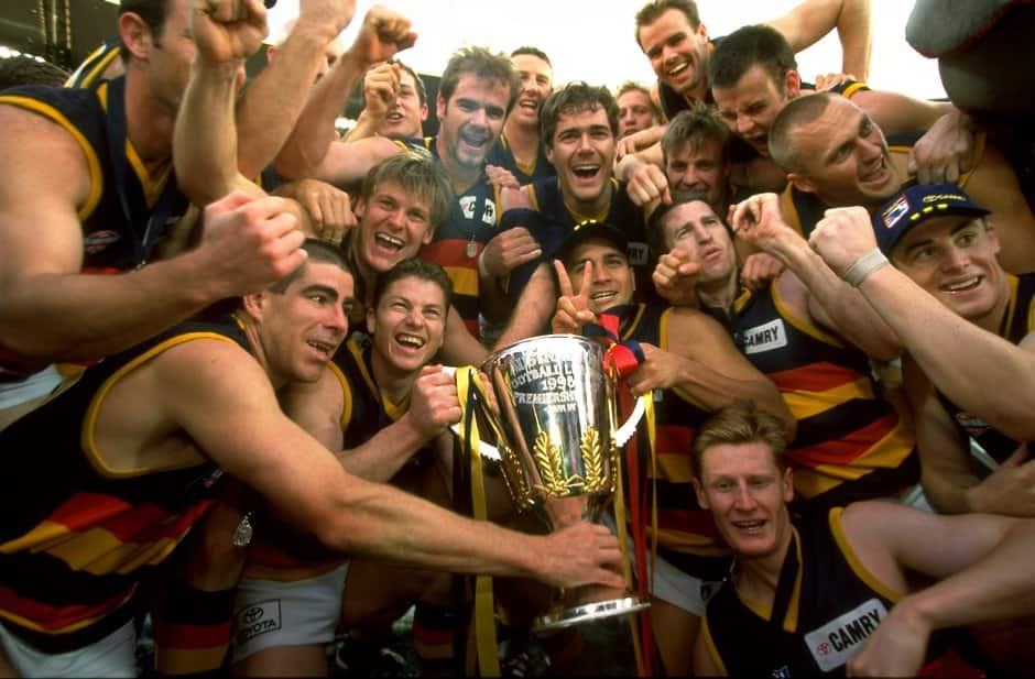 Adelaide Crows players celebrate with the Premiership Cup after winning the 1998 AFL Grand Final between North Melbourne and the Adelaide Crows at the Melbourne Cricket Ground in Melbourne on September 26, 1998.