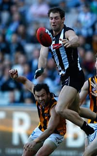 Travis Cloke and Jordan Lewis fight for the ball