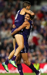 Michael Walters celebrates one of his four goals against Collingwood